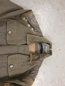 The collar / neck area of a really mouldy wax jacket which we serviced.